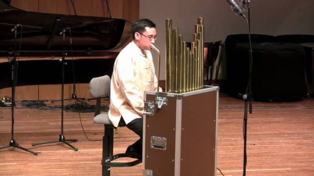 An Artist Playing the Alto Sheng