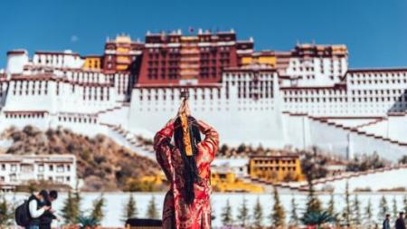 The Potala Palace and Pilgrims